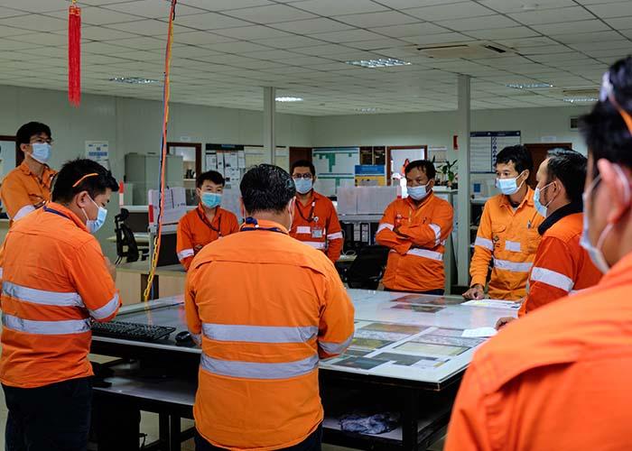 Team meeting at Ban Houayxai