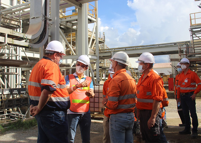 Team members at the Ban Houayxai process plant
